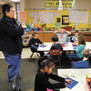 Lapel Elementary School kindergarten teacher Catherine Parker gives her students instructions on the project they are working on.