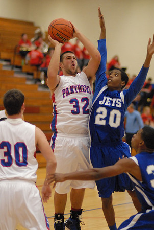 Elwood Panther Jared Bourff shoots over Anderson Preparatory Academy's Leo Harris during Tuesday night's game at Elwood High School.