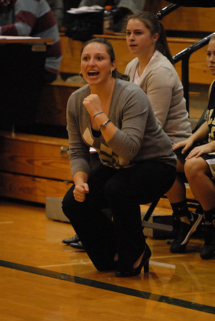 Shelbyville coach Amanda Harris roots her team on from the bench. (Rick wanted this for a future story. Thanks)