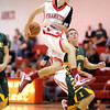 Frankton's Austin Compton passes the ball behind his back as he drives toward the basket as the Eagles hosted the Eastern Comets on Wednesday.