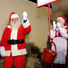 Santa kicks off the Salvation Army's Red Kettle drive after arriving at Mounds Mall on Saturday. The local Salvation Army set a goal of raising $210,000 during this year's fundraiser.