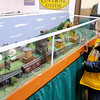 Blake Lawson, 5, checks out a HO scale modle train that is part of a model train exhibit at the Madison County Historical Society. The exhibit opens on November 30th.