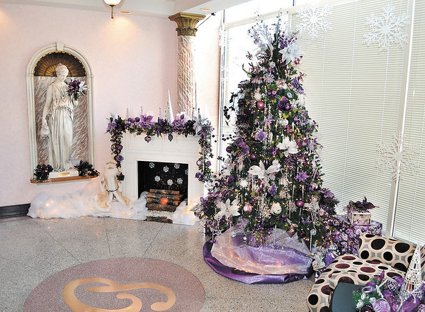 The tree gracing the lobby of the Paramount, named Purple Reign, was designed by Dan Alexander, music pastor of Park View Nazarene Church. It was sold at the auction to Merchants Bank for $1,300.