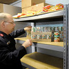 Capt. Dennis Marak, pastor at the Anderson Salvation Army, stands in the organizations food pantry on Monday.
