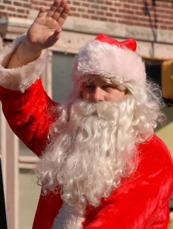 Santa Claus waves to the crowd at the Christmas Parade.