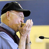 Marine Corps WWII veteran Sam Jones plays the songs for each branch of service on his harmonica during the Veteran's Day program at Eastside Elementary on Monday.
