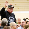 Marine Corps veteran and POW Mitch Waters waves to the crowd as he is acknowledged for his service in Vietnam during the Veterans Day Program at Daleveille Jr./Sr. High School on Friday.
