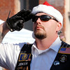 American Legion Post 117 honored the nation by playing the National Anthem at the Pendleton Christmas Parade Saturday afternoon.Warm temperatures and sunny skies brought hundreds of people out to the popular annual event.