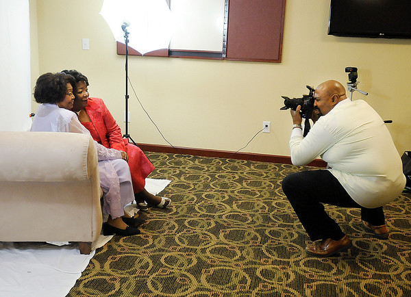 Mother and daughter cancer survivors Oleta Martin-McClurkin and Oraphine Stovall pose for a portrait session with photographer Anthony Johnson at the Best Western in Anderson on Saturday.