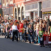 Hundreds of people line State Street in downtown Pendleton for the annual Christmas Parade.