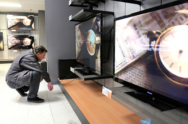 Chris Ryan of Cincinnati shops for a television at HH Greg during Black Friday in Anderson.
