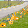 Painted pumpkins by Mike Carmichael decorate the road side of County Road 200 West south of Indiana 28, a Halloween tradition in northern Madison County.