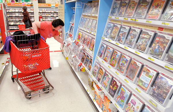Patti Layton of Anderson shops for video games at Target during Black Friday. Target opened this year at 9 p.m. on Thursday.