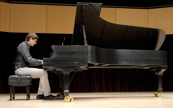 """Eric Butts performs his composition """"Ariel's Wish"""" during the student composers recital at the York Performance Hall at Anderson University on Monday. Butts wrote """"Ariel's Wish"""" for his wife Ariel to walk down the aisle to during their wedding this summer."""
