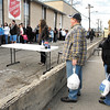 Tom Mosley, Vickie Duke, and Christa Conway, of the Quarter Horse Racing Association of Indiana, stand ready with more turkeys as their organization hosted a turkey give-away Monday morning at the Salvation Army parking lot.<br /> They gave away 100 frozen turkeys.
