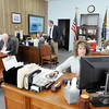 Staff members work in Mike Pence's district office in Anderson on Wednesday. From left are John Shettle, Kily Gaskill, Lani Czarniecki, Karrie Pardieck and Kevin Sulc. Governor elect Mike Pence will be keeping his offices open through the end of the year. It is unclear if newly elected U.S. Representative for District 5 Susan Brooks will have a district office in Anderson.
