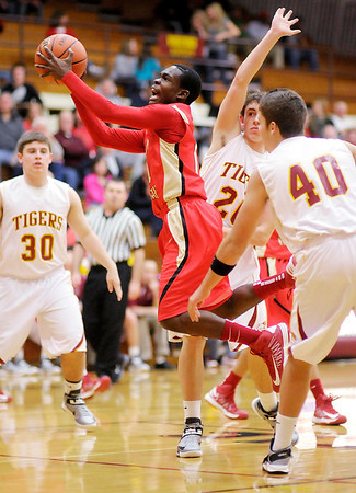 Liberty Christian's Terrence Campbell drives to the basket as the Alexandria Tigers hosted the Lions on Saturday.
