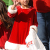 A youngster waves as the parade passes by.