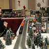 "Bret Jackson, 11, of Tipton looks at Larry Davenport's train display during the The ""Festival of Trees"" at the Paramount on Saturday. ""I've never seen anything like it,"" Jackson said."