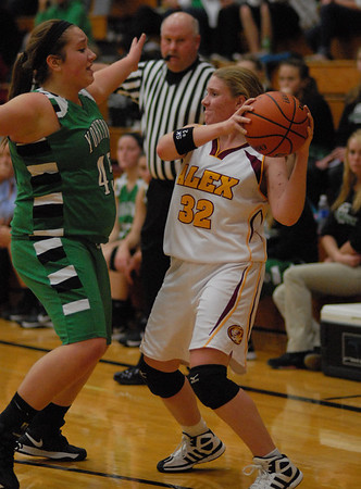 Pressley England looks for an open teammate while being guarded by Yorktown player Justine Irelan.