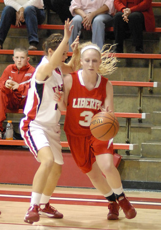 Liberty Christian senior Briana Ayers drives past a Frankton defender during first quarter action of the game.