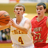 Alexandria's Layton Carroll passes the ball as he is guarded by Liberty Christian's Thatcher Rouse as the Tigers hosted the Lions on Saturday.