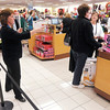April Scott directs customers to checkout lanes at Kohl's during Black Friday shopping in Anderson. Kohl's had all 15 of their checkout lanes open for shoppers.