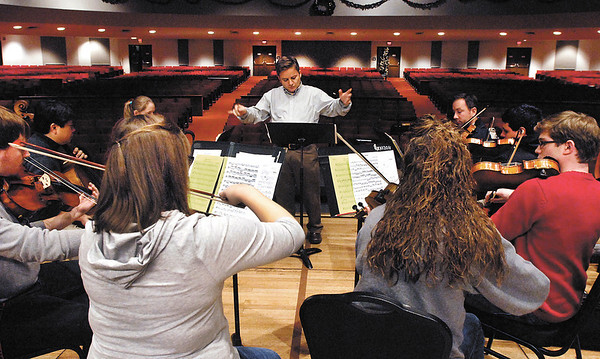 Gert Kumi conducts the AU Chamber Orchestra as they rehearse for upcoming Candles and Carols program.