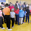 Students line up to thank veterans for their service after the Veteran's Day program at Eastside Elementary on Monday.