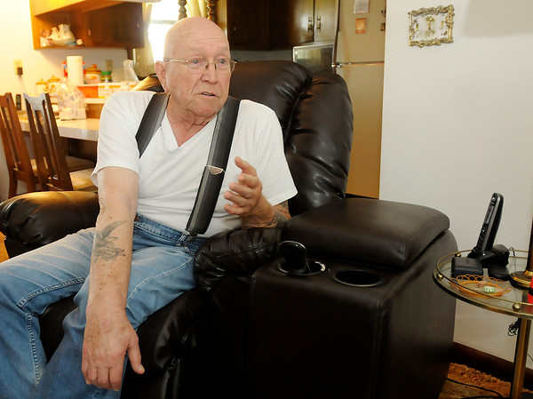 Cecil Stephenson talks about his service in the Navy during World War II at his Chesterfield home on Friday.
