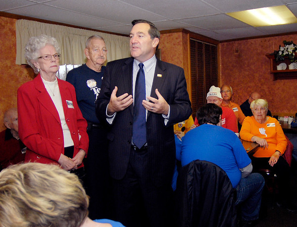 Joe Donnelly, Democrat  candidate for U.S. Senate, talks to supporters Wednesday morning at Lucy's Family Diner as his AM Workhorse bus tour stopped in Anderson.
