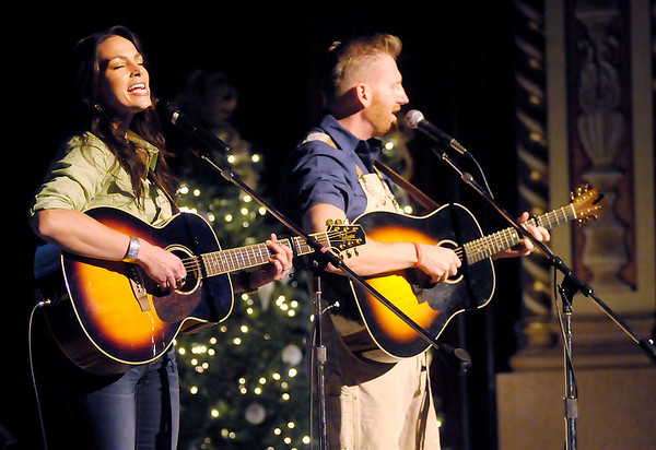 "From left, Joey Martin Feek and Rory Lee Feek of the Country music duo Joey & Rory perform their ""Joey + Rory's Farmhouse Christmas"" concert at the Paramount on Friday."