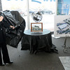 Autoworld President Mary Jamerson unveils renderings of what Autoworld's new dealerships will look like and what the current Ford Autoworld location will look like after it is converted into an Ivy Tech Automotive Institute during a press conference on Friday.
