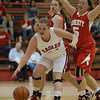 Kaylee Irwin keeps the ball away from Michaela Levell after rebounding for Frankton.
