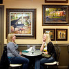 Erin Summers and Paige Gosnell, both from Alexandria, have a laugh over lunch under the artwork at Gaither Family Resource Cafe.