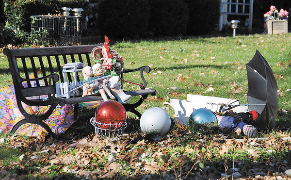 Umbrellas have blown from their perches over a bench in the front yard of Peggy Kruse's home in the Eastwood subdivision.