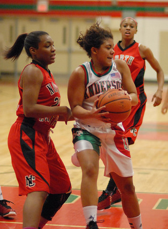 Anderson senior Sharice Jones brings down a rebound for the Indians.