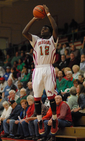 Anderson High School senior Chris Lemon takes a three point shot for the Indians.