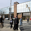 Employees and visitors evacuate the Madison County Government Center after a bomb threat was received on Wednesday.