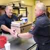 "Cpt. Robin Branch, right, from Station 1 picks up a Thanksgiving meal for his fire station from John Rigsby at Rigo's at Grandview on Thursday. The restaurant provided Thanksgiving meals for Man 4 Man, Stepping Stones and the city's firefighters working on the holiday.  Rigsby, a co-owner of the restaurant, said,""We've been very blessed here as a new business and we wanted to share that with the community."""