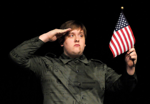 "Zach Myers salutes the flag in Anderson High School's production of ""Spoon River Anthology."""