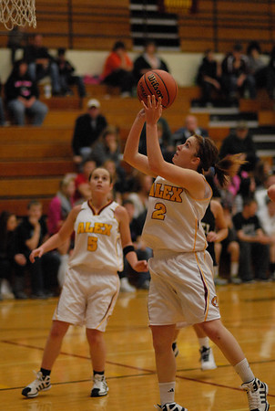Shanna Kelly takes a short jump shot for the Tigers.