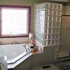 You cannot beat the beauty of a glass block shower. Jay and Stacie Vance built their Pendleton home with a five-piece ensuite that is the very definition of style. Matching the shower is a glass block window over the jetted tub that allows an ample supply of natural light but still ensures privacy. By choosing a beautiful but neutral tile for the floor and front of the tub, the Vances can rest assured that as styles and colors come and go, they only need to change the paint on the walls. The classic tile and glass blocks will coordinate with almost any color scheme.