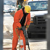 This worker from Miller Pipeline Inc. works a jackhammer as he cuts a hole in the right lane of Jackson Street at 11th Street Tuesday in downtown Anderson.  This is part of a long-term Vectren Corp. project in Anderson to replace old cast iron and steel natural gas lines with new plastic lines and connections.
