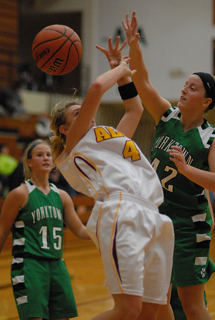 Alexandria Tiger Peyton Quinn loses the ball beneath the basket while attempting a  shot.