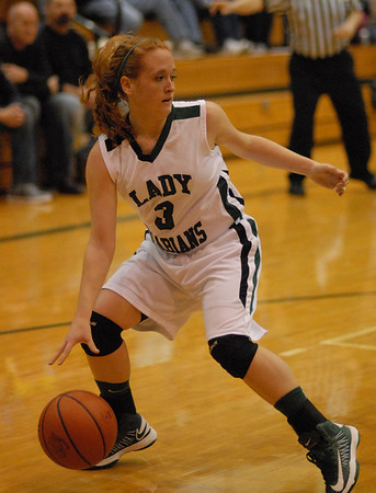 Pendleton Heights Arabian Meghan Dawson moves toward the basket during Friday night's contest against Shelbyville.