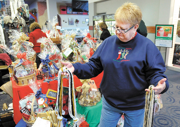 THB FILE PHOTO: Marcy Moore looks at scarfs during the Christmas Gift & Craft Show at Mounds Mall on Saturday.
