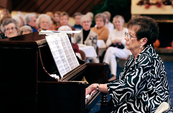 John P. Cleary | The Herald Bulletin<br /> Gloria Tincher plays the piano as she and David Cagley entertained those attending the Isabel Society Fall Luncheon Wednesday at the Harter House.<br /> The duo featured the music of Cole Porter for the society's annual fund-raising event benefiting United Faith Housing.