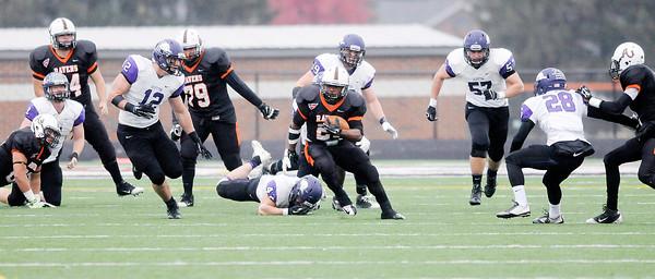 Don Knight | The Herald Bulletin<br /> Anderson University's Joshua Adkins breaks into the Bluffton secondary on Saturday.