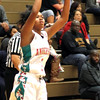 Photo by Chris Martin for The Herald Bulletin. Anderson's Janea Davies takes a 3 Pointer Tuesday night as the Lady Tribe hosted Pike.
